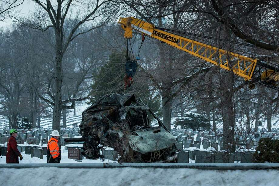 VALHALLA, NY - FEBRUARY 04:  The sport utility vehicle that was hit by a Metro-North train is removed from the site of the accident on February 4, 2015 in Valhalla, New York. The crash started a fire in the train car that killed seven people, including the driver of the vehicle. Photo: Andrew Burton, Getty Images / 2015 Getty Images