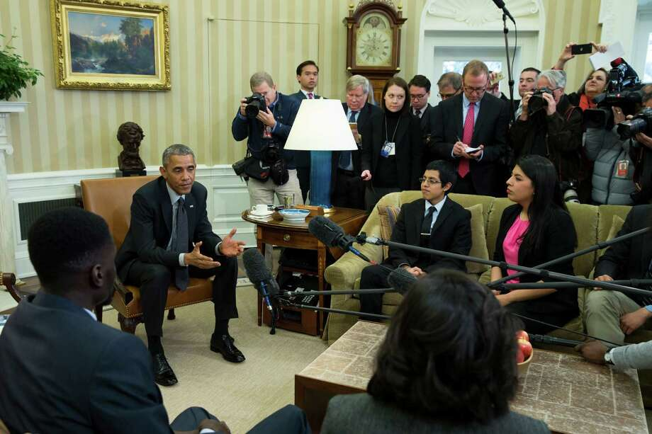 "President Barack Obama meets with a group of ""Dreamers"" in the Oval Office of the White House in Washington, Wednesday, Feb. 4, 2015. The president is accusing opponents of his immigration action of failing to think about the ""human consequences.""  The president spoke during an Oval Office meeting Wednesday with six of young immigrants who would be subject to eventual deportation under a bill passed by the House. The legislation would overturn Obama's executive actions limiting deportations for millions here illegally and giving them the ability to work. (AP Photo/Evan Vucci) Photo: Evan Vucci, STF / AP"
