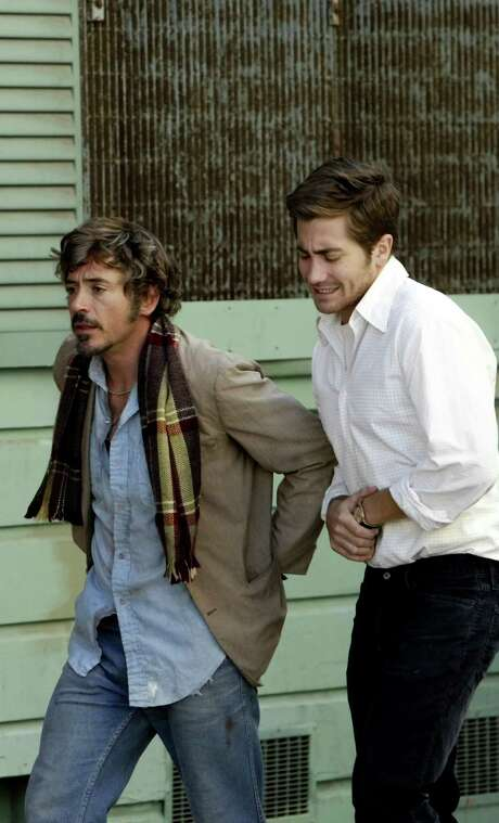 "Robert Downey Jr. (left) and Jake Gyllenhaal on the set of ""Zodiac,"" some of which was shot in and around The Chronicle Building. Photo: Carlos Avila Gonzalez / SFC / The Chronicle"