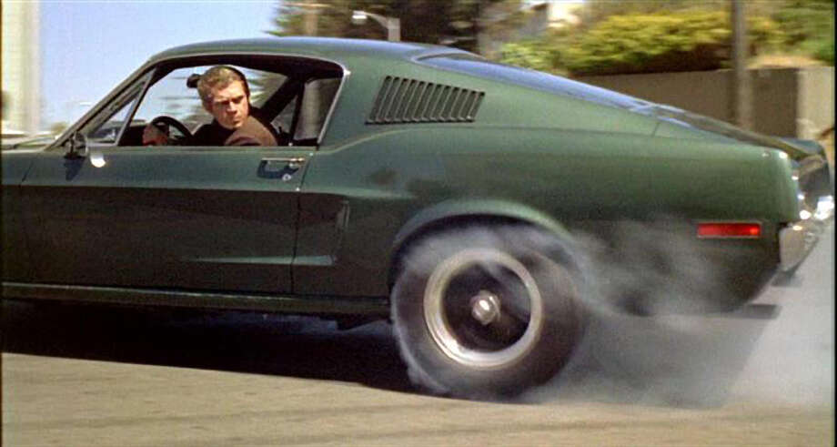 "Steve McQueen on the set of ""Bullitt,"" in which he drove in the chase scene. Photo: Courtesy Warner Bros. Pictures / File Photo"
