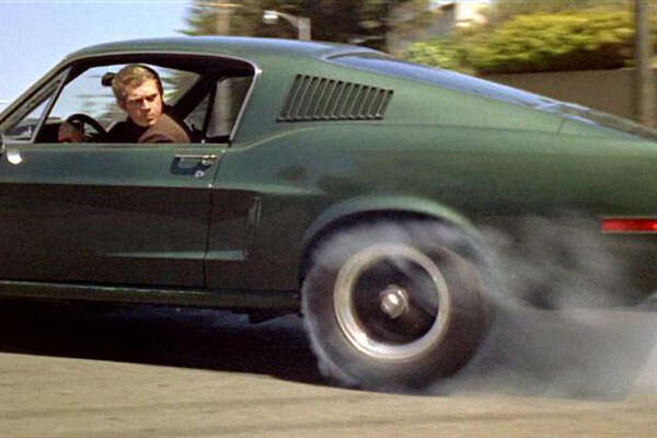 """Steve McQueen on the set of """"Bullitt,"""" in which he drove in the chase scene."""