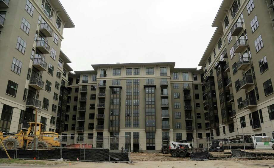 Developer opens luxury apartments as market likely to slow ...