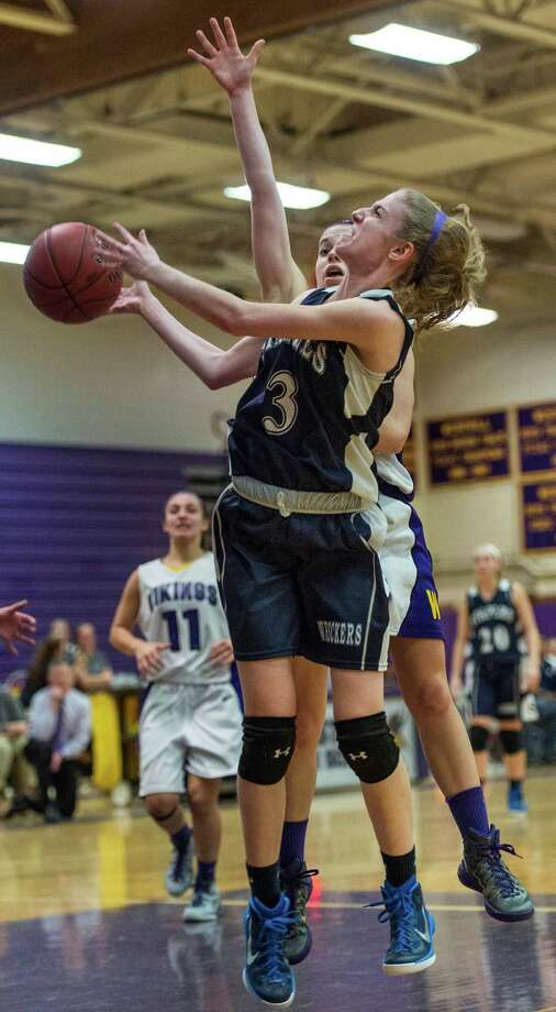 Staples high schoolâÄôs Abigail Lustig goes up for a shot during a girls basketball game against Westhill high school played at Westhill high school Stamford, CT on Friday, December 12th, 2014 Photo: Mark Conrad / Connecticut Post Freelance