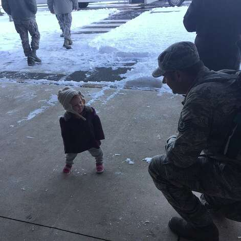 Air Force Tech. Sgt. Eric Nardacci, a Columbia High School graduate, returned from his most recent deployment to the Middle East on Jan. 28 and was greeted at McGuire Air Force Base by his wife, Allyson, and 13-month-old daughter Sydney, who he hadn?t seen in more than six months. Here they are seen at the passenger terminal in a photo submitted by Eric's father Fred Nardacci of East Greenbush. Eric's wife is also a Air Force veteran and works in the same squadron as her husband. They live in Medford Lakes, N.J. Eric, a cancer survivor, has been in the Air Force for over 12 years and is a crew chief on C-17 cargo planes. (Fred Nardacci)