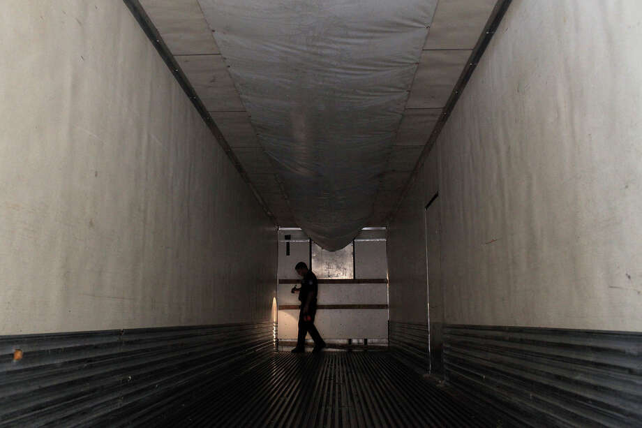A federal agriculture specialist inspects the interior of a tractor-trailer after all of its produce has been removed for inspection at the Pharr-Reynosa International Bridge port of entry. Gov. Greg Abbott signed legislation providing $725,000 over the next biennium in matching funds to entities that reimburse the federal government for overtime or added staffing for agricultural inspections. Photo: Express-News File Photo / SAN ANTONIO EXPRESS-NEWS