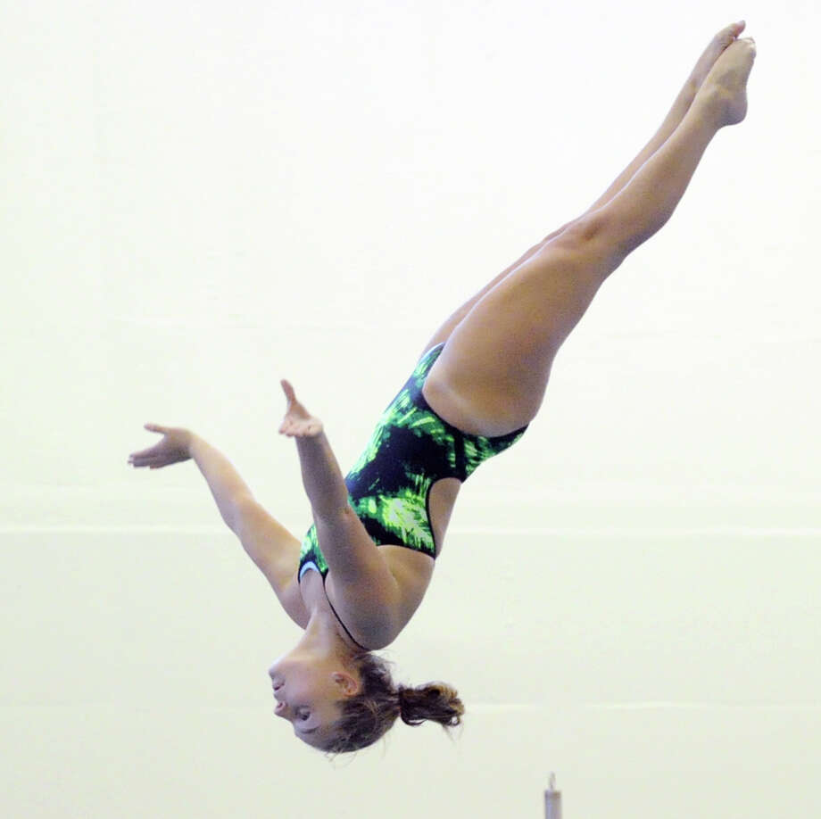 Elizabeth Fitzpatrick of Greenwich Academy competes in the diving during the girls high school swimming meet between Greenwich Academy and Convent of the Sacred Heart at the Brunswick School in Greenwich, Conn., Wednesday, Feb. 4, 2015. Photo: Bob Luckey / Greenwich Time
