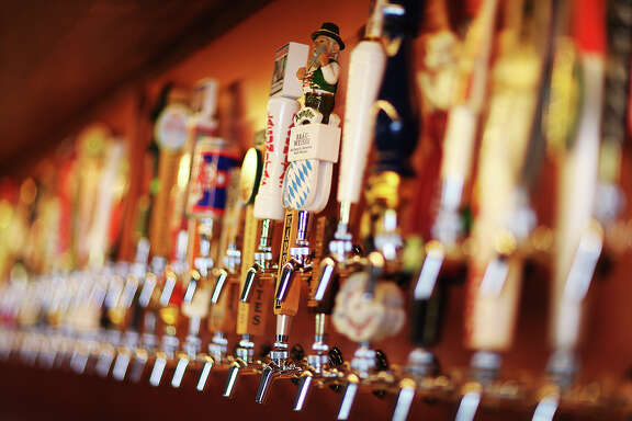 Two rows of taps line the wall of the bar at The Hoppy Monk, Tuesday, Feb. 3, 2015. The establishment, based out of El Paso, opened it's San Antonio location off Loop 1604 in the Stone Oak area. They serve 219 beers and that includes 99 on tap.