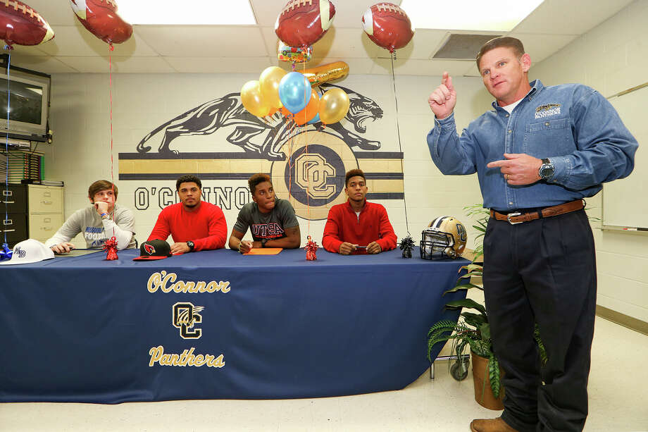 O'Connor coach David Malesky (from right) speaks as Jekovan Holmes (Texas Lutheran University), Darryl Godfrey (UTSA), Josia Velazquez (Trinity Valley Junior College) and Janathan McEntire (Missouri Baptist University) sign their national letters of intent at O'Connor High School on Wednesday, Feb. 4, 2015.  MARVIN PFEIFFER/ mpfeiffer@express-news.net Photo: Marvin Pfeiffer, Staff / San Antonio Express-News / Express-News 2015