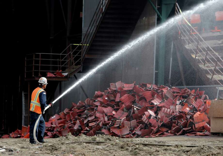 A worker sprays water to keep the dust down as demolition of Candlestick Park officially began on Feb. 4, 2015. State health codes restrict the use of recycled water for dust mitigation. Photo: Michael Macor / The Chronicle / ONLINE_YES