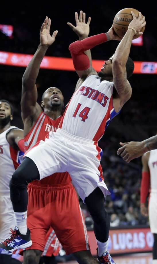 Detroit Pistons' D.J. Augustin (14) takes a shot against Houston Rockets' Joey Dorsey (8) during the second half of an NBA basketball game Saturday, Jan. 31, 2015, in Auburn Hills, Mich. Augustin scored 28 points and dished out 12 assists in Detroit's 114-101 win. (AP Photo/Duane Burleson) Photo: Associated Press
