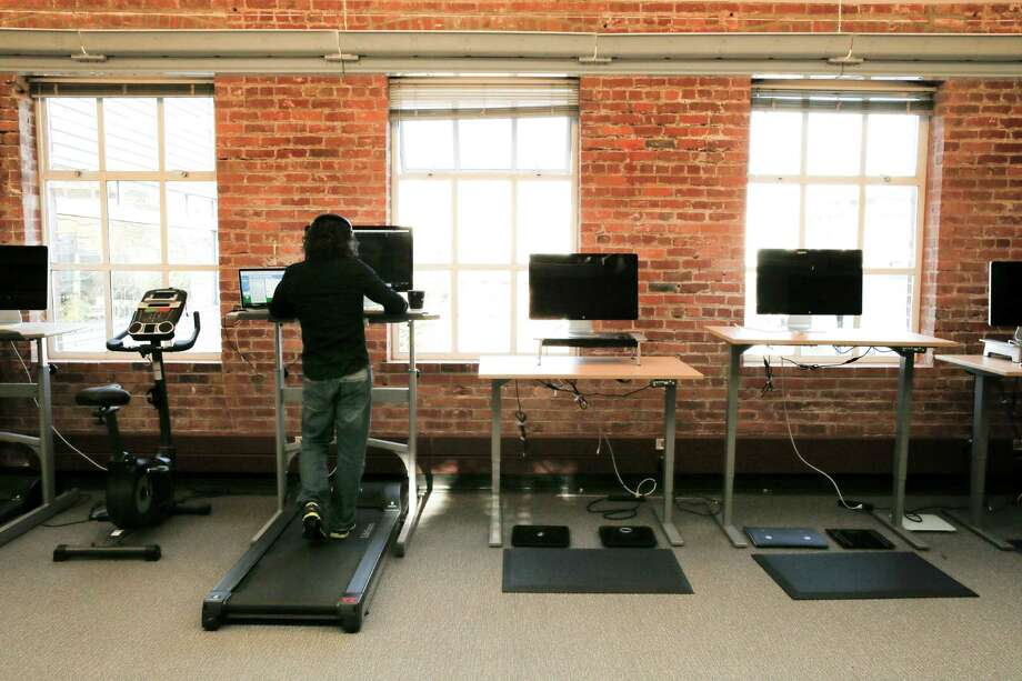 Jason Buckner, a member of the Web client team works at a treadmill desk at the offices of MyFitnessPal. Photo: Michael Macor / The Chronicle / ONLINE_YES