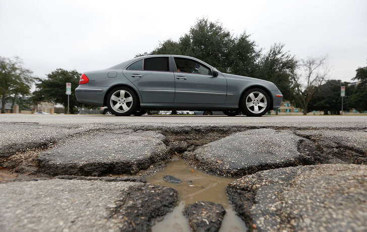 Mayor Annise Parker says the policy of prioritizing big road repairs has left the city struggling to make short-term fixes on potholes, such as this one on Westheimer near Eastside Street.