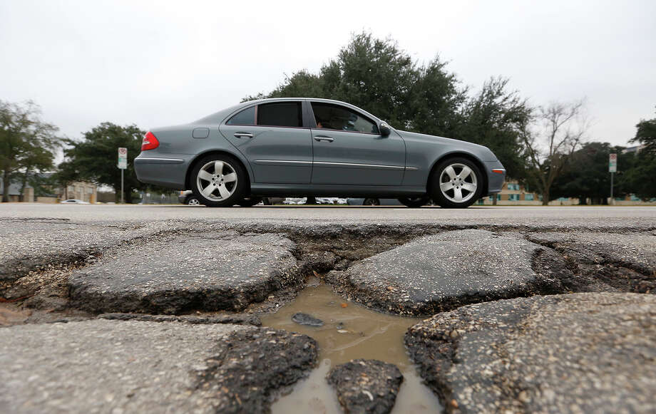 As of this spring, $655 million had been spent or earmarked for new projects under ReBuild Houston, with almost 100 projects completed. That work includes 515 miles of rebuilt or repaved streets, 697 miles of ditches graded and 188 miles of storm sewers cleaned - all while paying down old debt, supporters say. Photo: Cody Duty, Staff / © 2014 Houston Chronicle