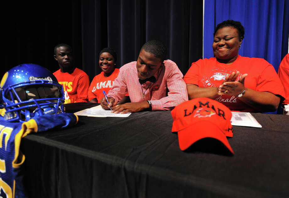 The Panther's Rodney Randle ceremoniously signs his intent to play for Lamar University during a special gathering at Ozen High School on Wednesday.  Photo taken Wednesday, February 04, 2015  Guiseppe Barranco/The Enterprise Photo: Guiseppe Barranco, Photo Editor