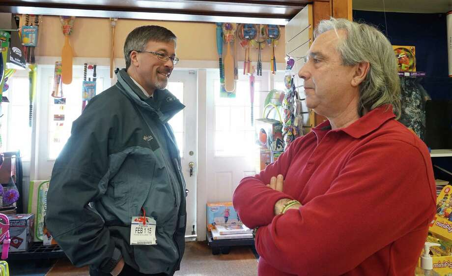 Community and Economic Development Director Mark Barnhart, left, talks with Mark Crofutt, owner of Blinn's Toy Store about Crofutt's decision to close the store. Photo: Genevieve Reilly / Fairfield Citizen