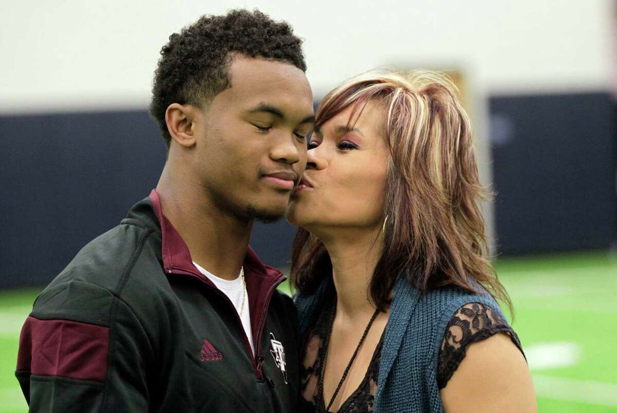 Allen quarterback Kyler Murray gets a kiss from his mother, Missy, on Wednesday after making official his decision to compete for playing time with the Aggies next season.