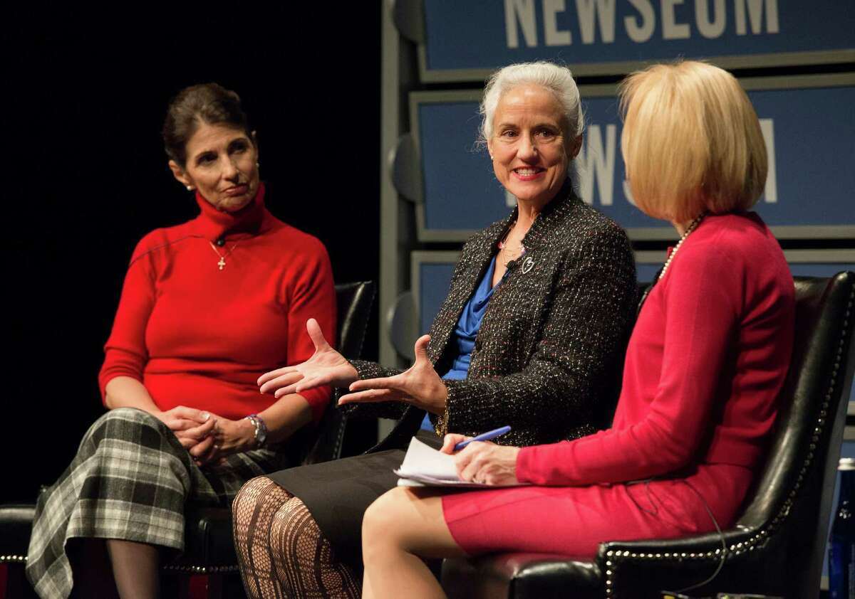 Diane Foley, left, and Debra Tice take part Wednesday in a program on threats to journalism moderated by Judy Woodruff, right, in Washington. Foley's and Tice's sons are both victims of Islamic militants.