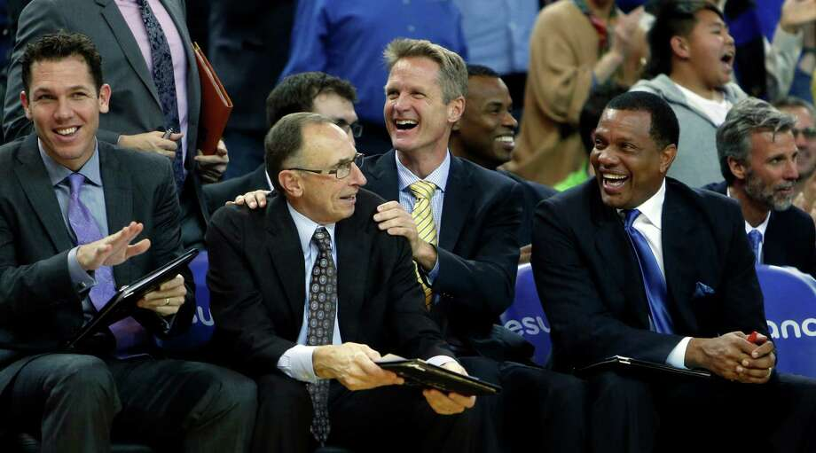 Warriors head coach Steve Kerr (center, in yellow tie) has surrounded himself with a group of assistants that includes, Row 1 from left, Luke Walton, Ron Adams and Alvin Gentry, and Row 2, to right of Kerr, Jarron Collins and Bruce Fraser (far right). Photo: Scott Strazzante / The Chronicle / ONLINE_YES