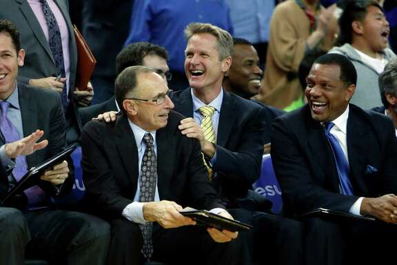 Warriors head coach Steve Kerr (center, in yellow tie) has surrounded himself with a group of assistants that includes, Row 1 from left, Luke Walton, Ron Adams and Alvin Gentry, and Row 2, to right of Kerr, Jarron Collins and Bruce Fraser (far right).