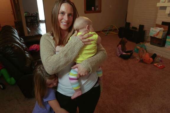 "Krystal Bettilyon, with her daughters in Deer Park, said after researching vaccines, she became uncomfortable. ""It's a personal choice,"" she said."
