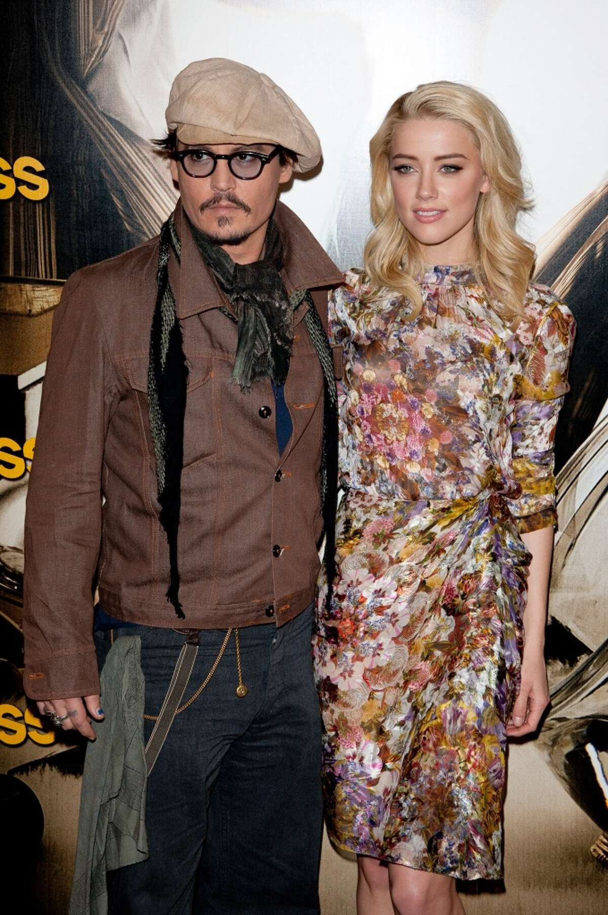Johnny Depp and Amber Heard pose during the 'Rhum Express' Photocall at Hotel Paris Plaza Athenee on November 8, 2011 in Paris, France.