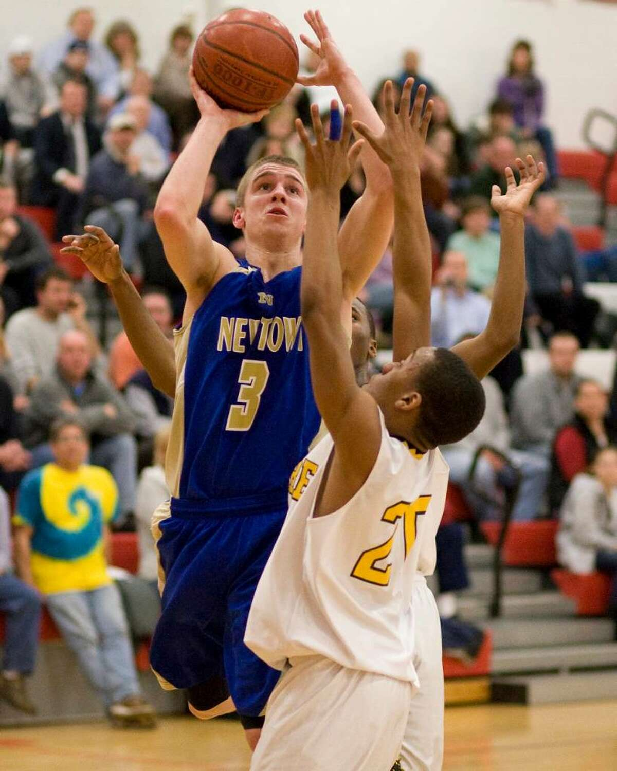 Newtown's Andy Lapple (3) shoots over Kolbe Cathedral defender Elton Perry during the Nighthawks' SWC Tournament semifinal win Tuesday night at Pomperaug High School.
