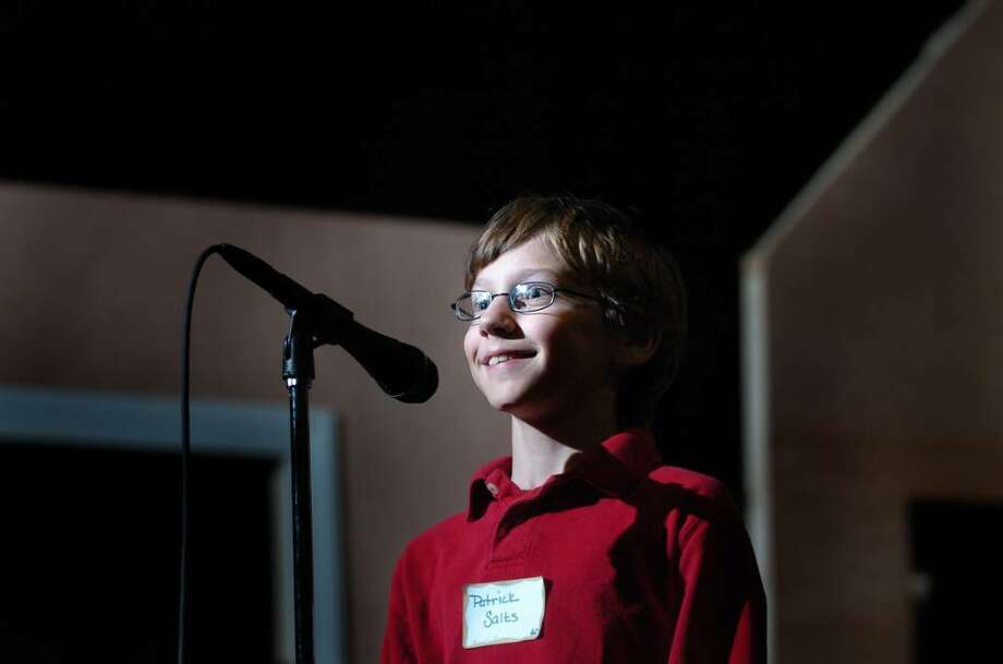 Patrick Salts, a Riverfield School student, smiles broadly after winning Fairfield's townwide spelling bee , sponsored by the Junior Women's Club of Fairfield, Thursday Feb. 25, 2010 at Roger Ludlowe Middle School. Photo: Autumn Driscoll / Connecticut Post