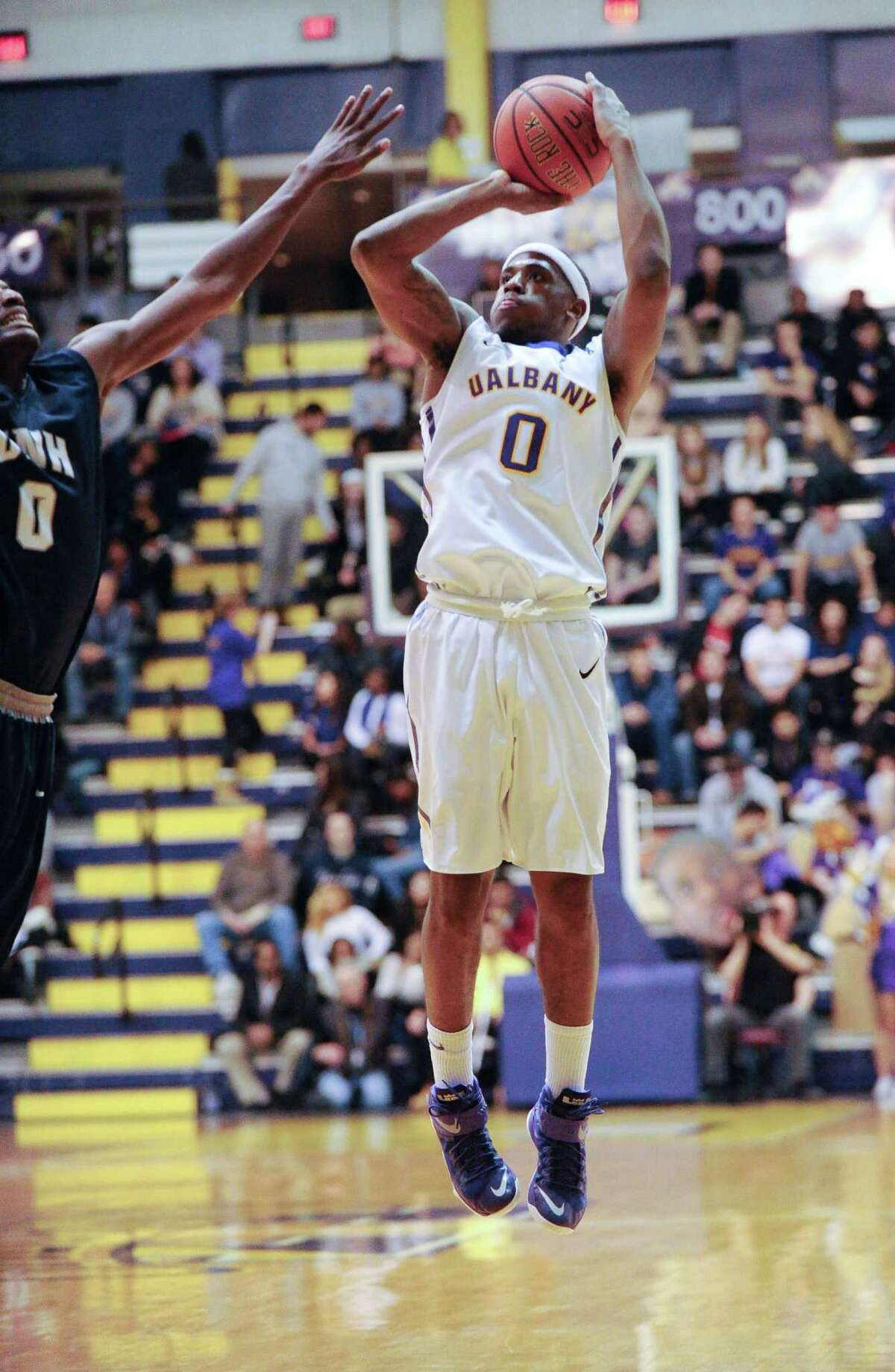 UAlbany's Evan Singletary (0)puts up a shot against New Hampshire during the first half of an NCAA college basketball game at the SEFCU Arena in Albany, N.Y., Wednesday, Feb. 4, 2015. (Hans Pennink / Special to the Times Union) ORG XMIT: HP106