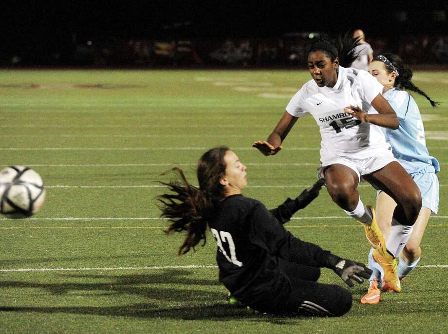 Braelyn Spears (15) of Incarnate Word kicks the ball toward the goal as Antonian goalkeeper Cami Ramon attempts to block the shot. The ball was wide of the net. Photo: Billy Calzada /San Antonio Express-News / San Antonio Express-News