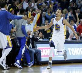 Golden State Warriors' Stephen Curry celebrates his 3-pointer giving him 51 points in 128-114 win over Dallas Mavericks during NBA game at Oracle Arena in Oakland, Calif. on Wednesday, February 4, 2015.