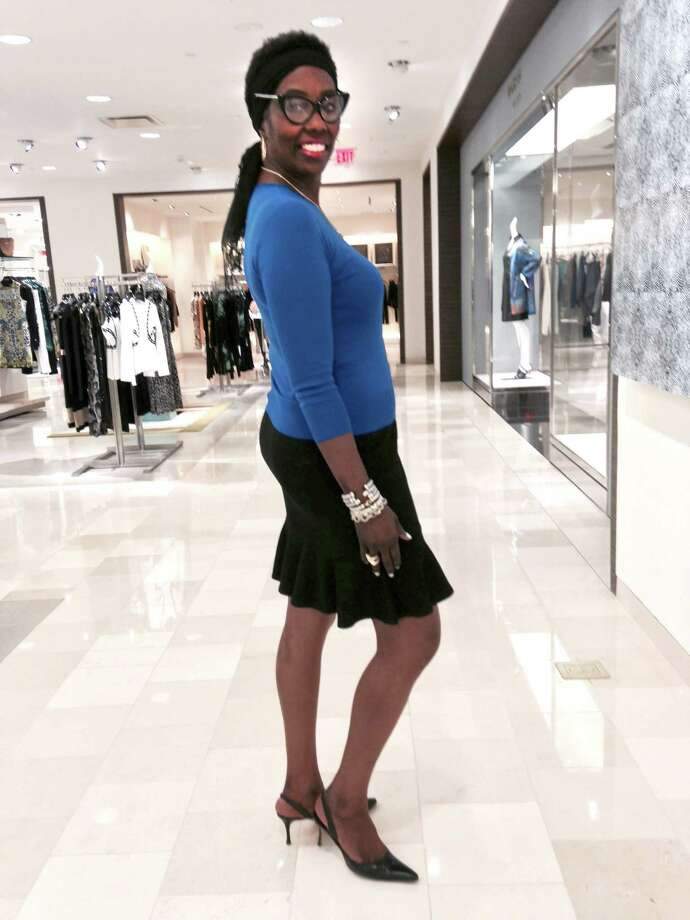 Claudia Coleman shows us how to wear one of winter's top hues, vibrant cobalt blue in her three-quarter sleeve top over a flared pencil skirt. Her look is anchored with pointy-toe slingback kitten heels and she accessorizes with a deep stack of David Yurman bangles. But it's what's on her face that we absolutely love: Tom Ford oversized cat-eye frames that suit her modern style well. Photo: San Antonio Express-News / San Antonio Express-News