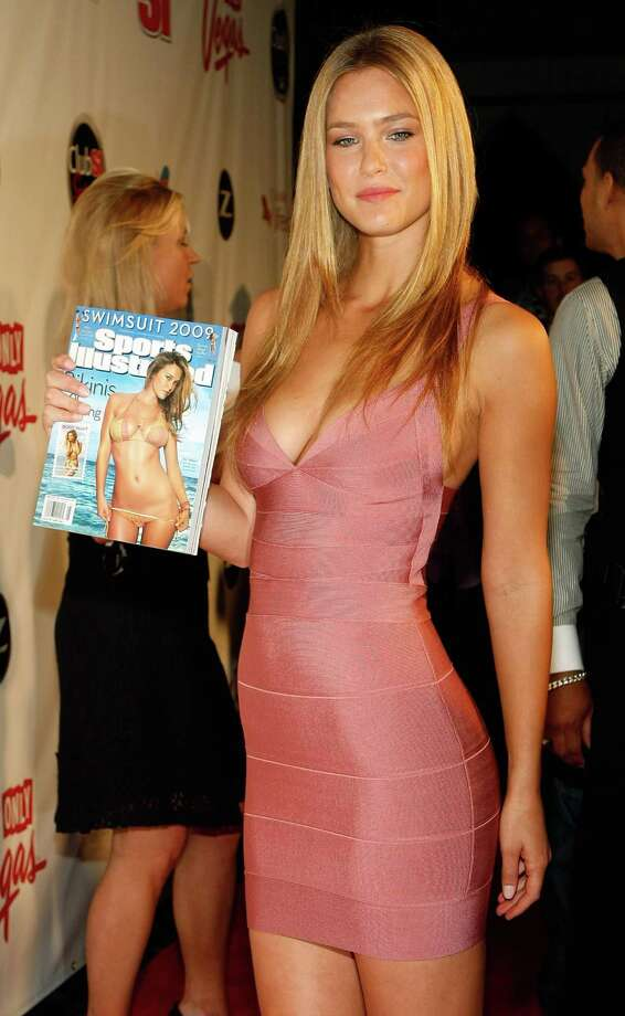 Model Bar Refaeli arrives at the LAX Nightclub at the Luxor Resort & Casino during a launch party for the 2009 Sports Illustrated Swimsuit Issue February 12, 2009 in Las Vegas, Nevada. Refaeli is holding the issue with her photo on the cover. Photo: Ethan Miller, Getty Images / 2009 Getty Images