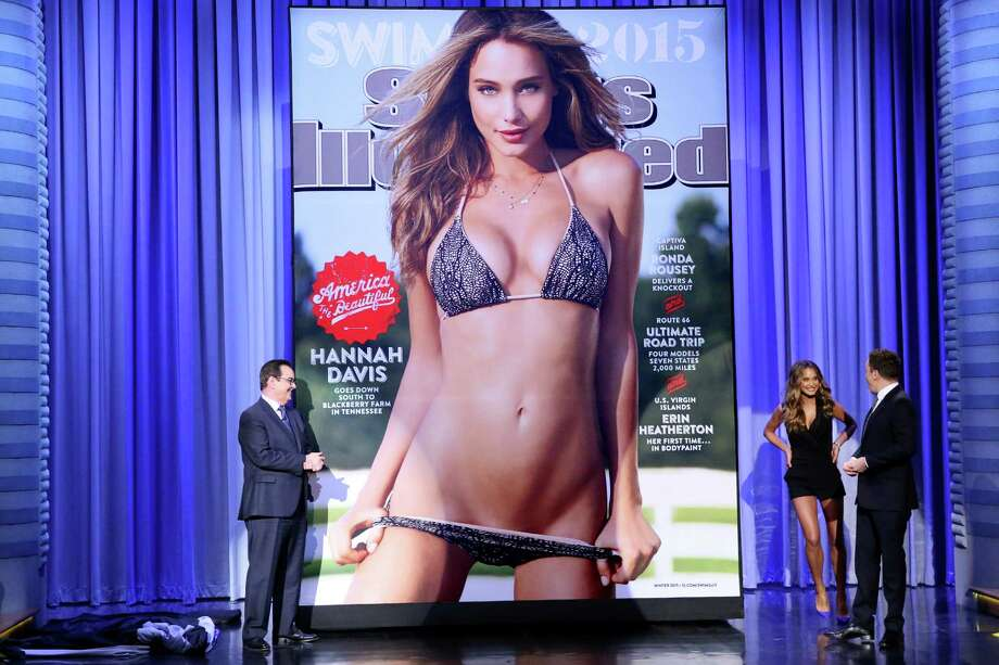 Announcer Steve Higgins, model Hannah Davis and host Jimmy Fallon reveal the 2015 Sports Illustrated Swimsuit Issue cover on February 4, 2015.Click through the photos to see the 50 years of the Sports Illustrated Swimsuit Issue. Photo: NBC, Getty Images / 2015 NBCUniversal Media, LLC