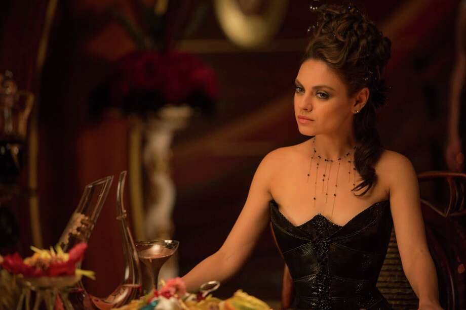 "Mila Kunis gets a chance to marry a prince in ""Jupiter Ascending,"" but she prefers the guy who likes to be scratched behind his pointy ears. Photo: Murray Close /McClatchy-Tribune News Service / Warner Bros. Pictures"