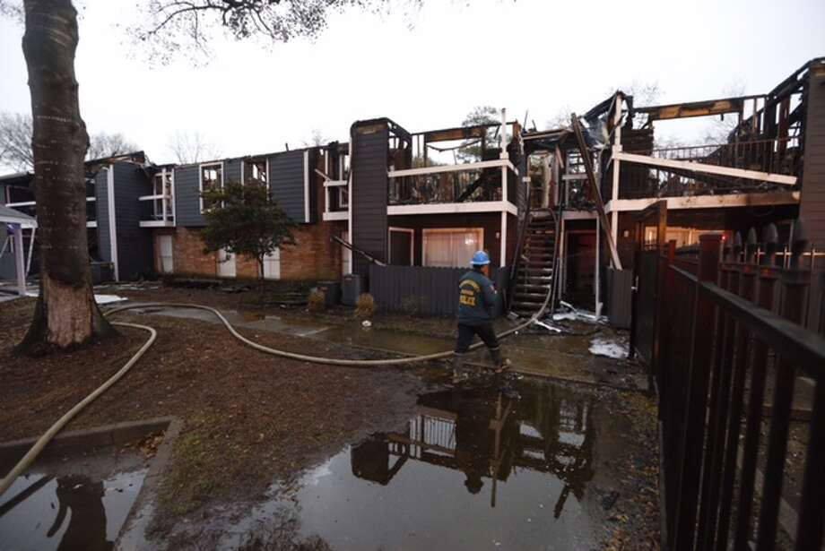 A two-alarm fire broke out about 4 a.m. Thursday at 17700 Red Oak Drive near Drava, according to Harris County fire officials. Firefighters got the blaze under control about two hours later. Photo: Cody Duty / Houston Chronicle