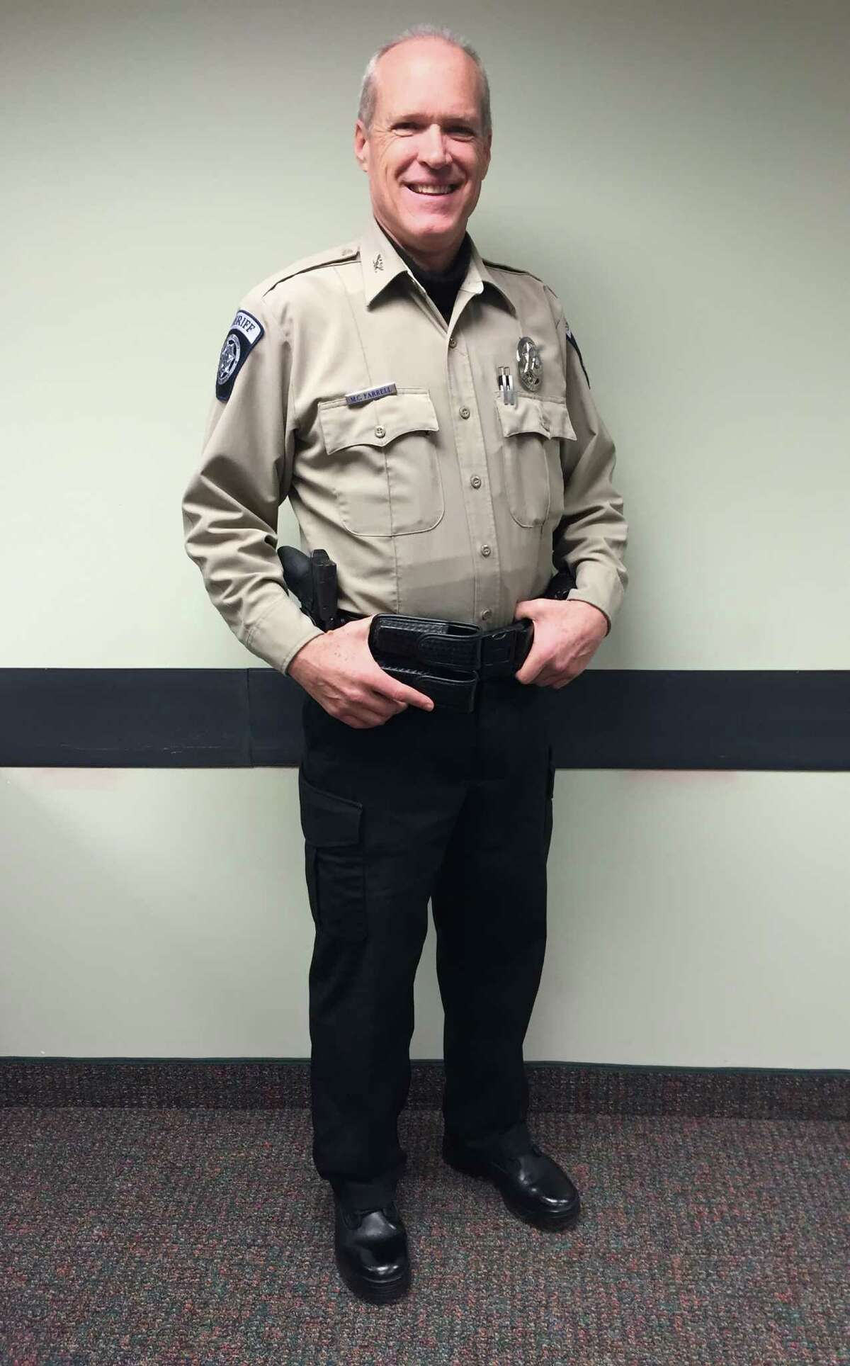 This photo provided by the Sublette County Sheriff's Office shows Undersheriff Mark Farrell wearing a new uniform at the Sheriff's Office on Monday, Feb. 2, 2015, in Pinedale, Wyo. The new sheriff of a Wyoming county has banned his deputies from wearing cowboy hats and cowboy boots, a change that led one longtime deputy to retire rather than give up his Western attire. Sublette County Sheriff Stephen Haskell imposed the new dress code in the western Wyoming county that includes Pinedale, which True West magazine recently named a true Western town.