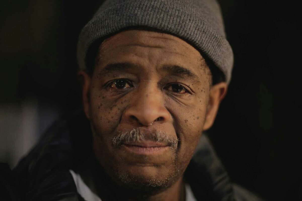 In this Jan. 28, 2015 photo, James Robertson, 56, poses for a photo outside of his home in Detroit. Hundreds of people have contributed tens of thousands of dollars to help Robertson, who says he typically walks 21 miles (34 kilometers) to get to and from work. Robertson began making the daily trek to the factory where he molds parts after his car stopped working ten years ago and bus service was cut back. He's had perfect attendance for more than 12 years. DETROIT NEWS OUT;