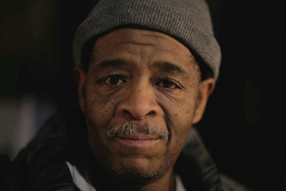 In this Jan. 28, 2015 photo, James Robertson, 56, poses for a photo outside of his home in Detroit.  Hundreds of people have contributed tens of thousands of dollars to help Robertson, who says he typically walks 21 miles (34 kilometers) to get to and from work. Robertson began making the daily trek to the factory where he molds parts after his car stopped working ten years ago and bus service was cut back. He's had perfect attendance for more than 12 years.   DETROIT NEWS OUT; Photo: Ryan Garza, AP / Detroit Free Press