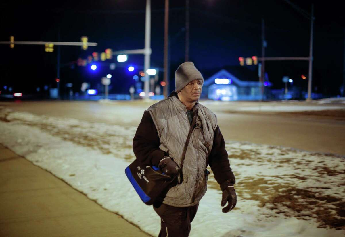 James Robertson, 56, of Detroit, makes his way home after working his shift at Schain Mold & Engineering in Rochester Hills on Jan. 9, 2015. Hundreds of people have contributed tens of thousands of dollars to help Robertson, who says he typically walks 21 miles (34 kilometers) to get to and from work. Robertson began making the daily trek to the factory where he molds parts after his car stopped working ten years ago and bus service was cut back. He's had perfect attendance for more than 12 years. DETROIT NEWS OUT;