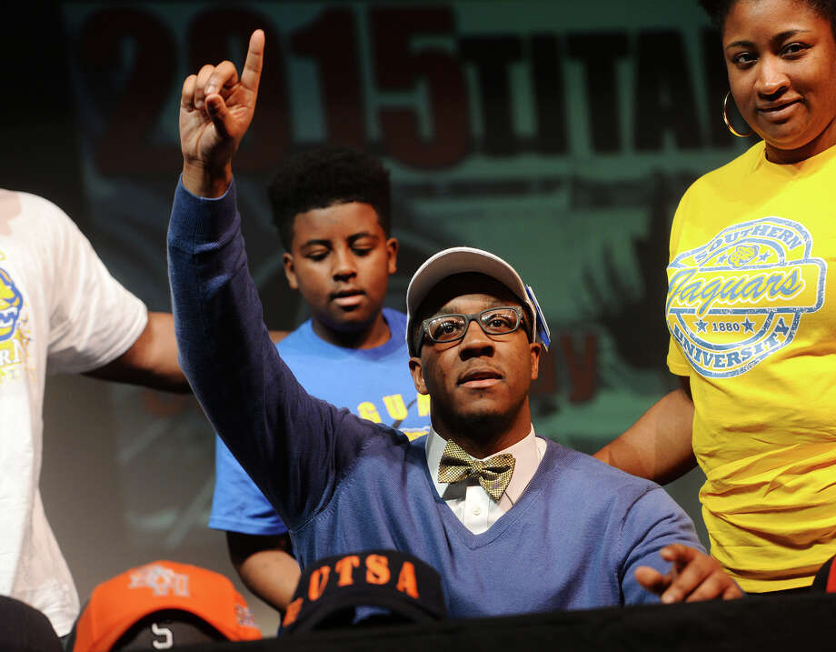 Jaron Johnson poses for photos after signing with Southern University during Wednesday's ceremony at Port Arthur Memorial. Port Arthur Memorial High School held a national signing day ceremony in the school's auditorium Wednesday afternoon. Fifteen student athletes committed to college teams. Photo taken Wednesday 2/4/15 Jake Daniels/The Enterprise Photo: Jake Daniels / ©2014 The Beaumont Enterprise/Jake Daniels