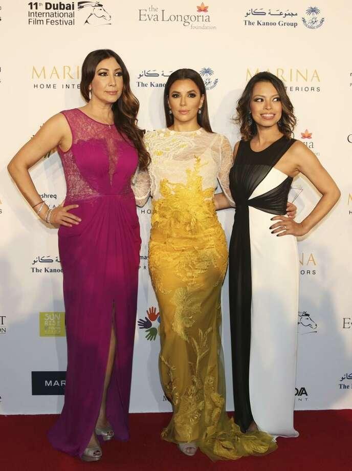 Maria Bravo, Eva Longoria and Alina Peralta post on the red carpet of the global Gift Gala in Dubai on Dec. 14. Photo: Associated Press