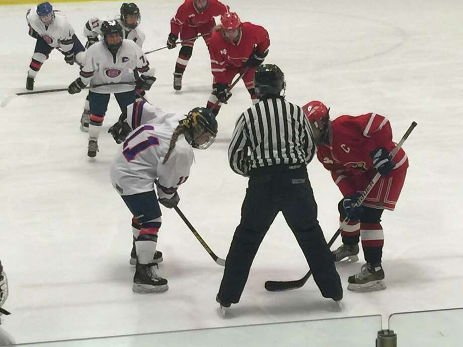 Stamford-Westhill-Staples captain Casssie Miolene, left, and Greenwich captain Haley Raftery prepare to take a faceoff during the teams' game on Wednesday night at Terry Conners rink. Miolene scored twice as Stamford won 3-1. Photo: Ryan Lacey/Staff / Westport News Contributed