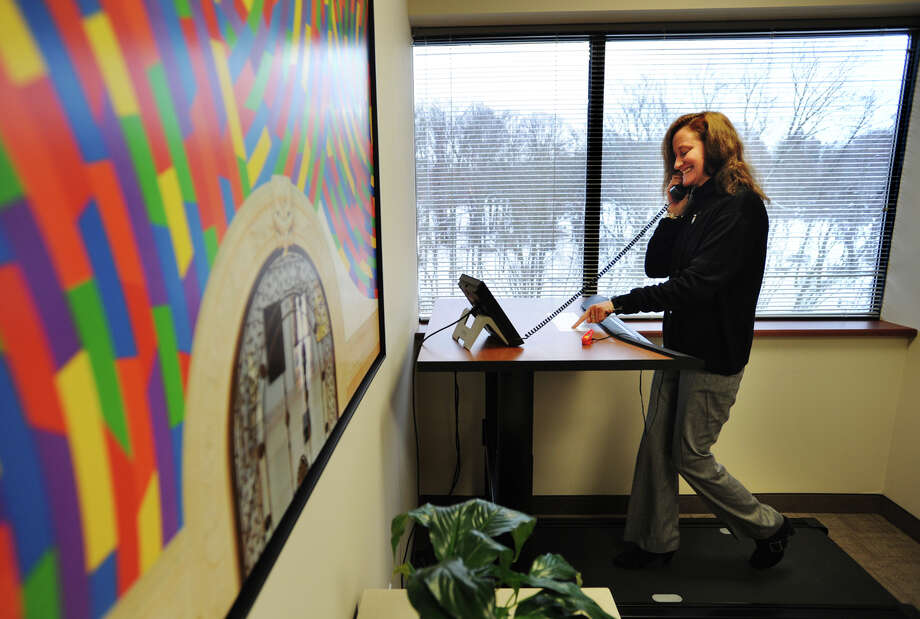 Operations Manager Linda McDonough demonstrates the Steelcase Walking Desk available for use by clients at Symphony Workplaces at 55 Greens Farms Road in Westport, Conn. on Wednesday, February 4, 2015. Photo: Brian A. Pounds / Connecticut Post