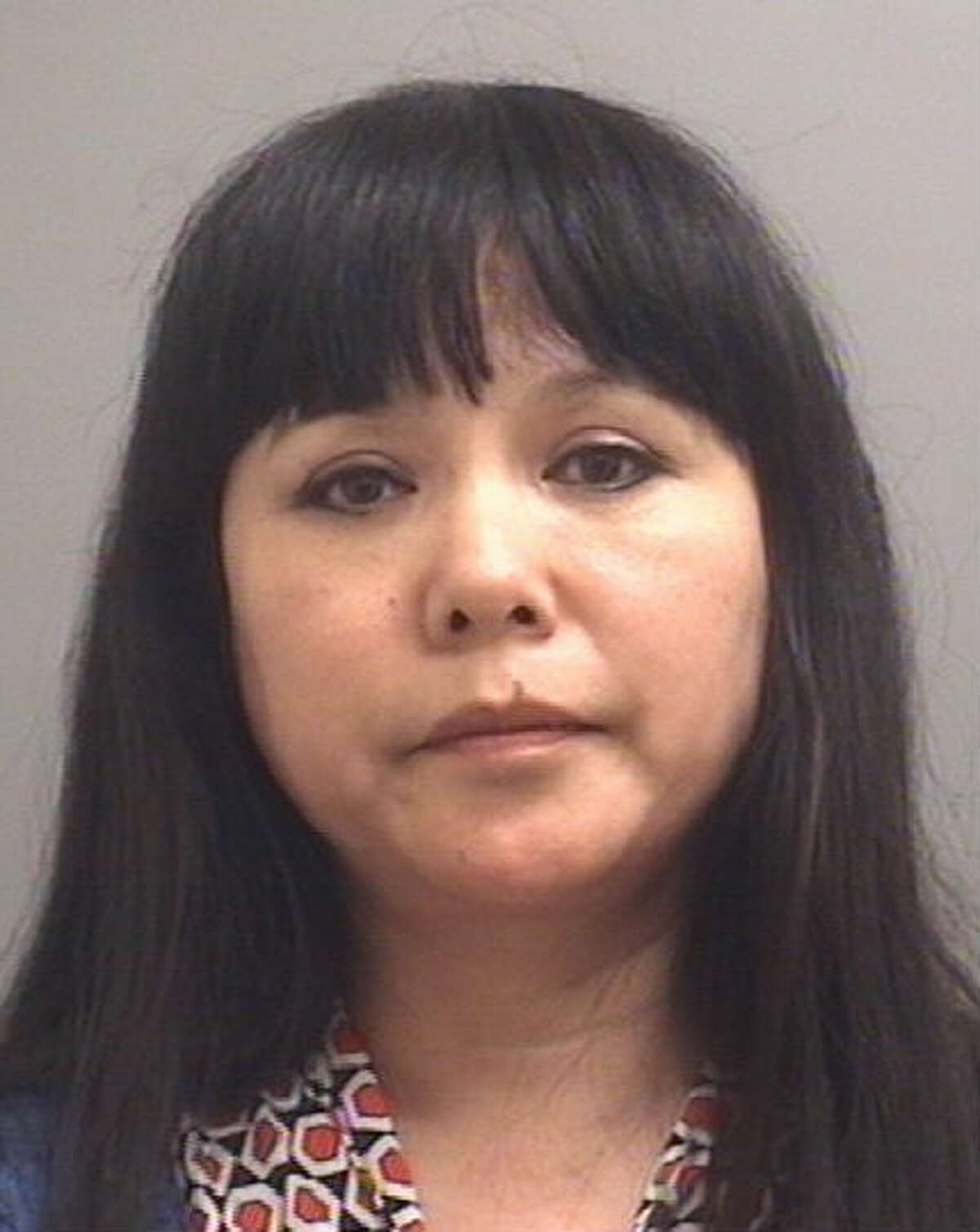 Ming Yu Silverthorne, 46, at Yu's Massage is facing a charge of having an unlicensed massage therapist on duty.
