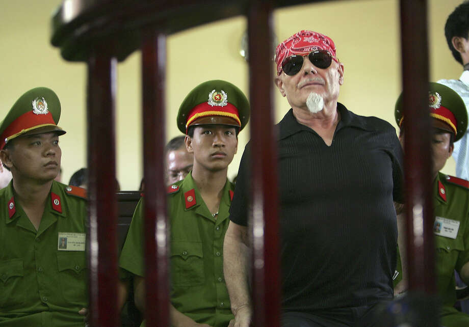 FILE - Former British Glam-Rocker, Gary Glitter, listens to the judge before the guilty verdict is announced at the People's Courthouse March 3, 2006 in Ba Ria, Vietnam. Glitter, age 61, is sentenced to three years in prison for committing obscene acts with two underaged girls in Vietnam. Photo: Paula Bronstein, Getty Images / 2006 Getty Images