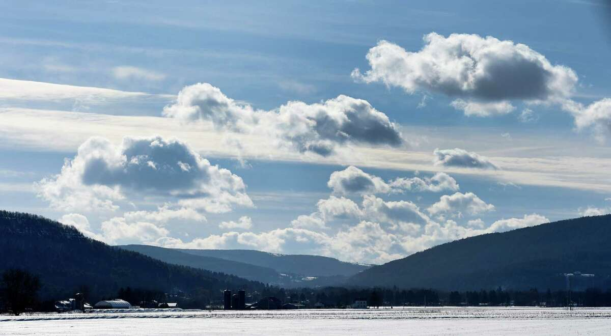 A beautiful cloud formation sits over the snow covered farm fields of Schoharie Valley near Route 30 Thursday, Feb. 5, 2015, between the Village of Schoharie and Middleburgh, N.Y. (Skip Dickstein/Times Union)
