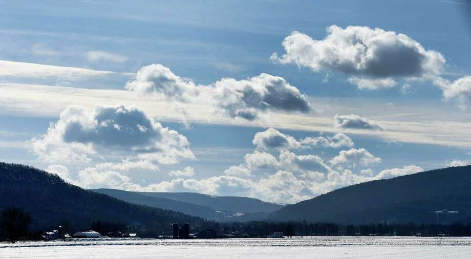 A beautiful cloud formation sits over the snow covered farm fields of Schoharie Valley near Route 30 Thursday, Feb. 5, 2015, between the Village of Schoharie and Middleburgh, N.Y.  (Skip Dickstein/Times Union) Photo: SKIP DICKSTEIN