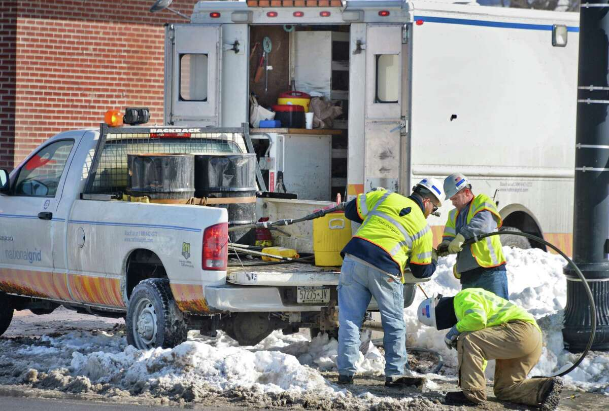 National Grid crews finish repairs on a gas line at 125th St. and Second Ave. Thursday Feb. 5, 2015, in Troy, N.Y. About 50 Lansingburgh homes were left without gas service on Tuesday and Wednesday when water got into the pipe system and froze, National Grid officials said. (John Carl D'Annibale / Times Union)