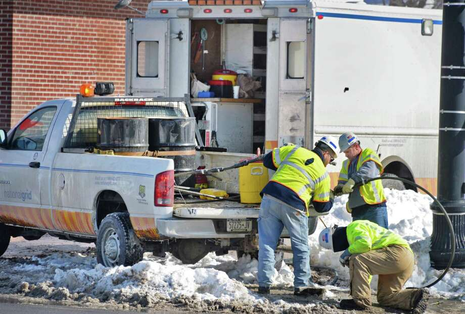 National Grid crews finish repairs on a gas line at 125th St. and Second Ave. Thursday Feb. 5, 2015, in Troy, N.Y. About 50 Lansingburgh homes were left without gas service on Tuesday and Wednesday when water got into the pipe system and froze, National Grid officials said. (John Carl D'Annibale / Times Union) Photo: John Carl D'Annibale / 10030491A