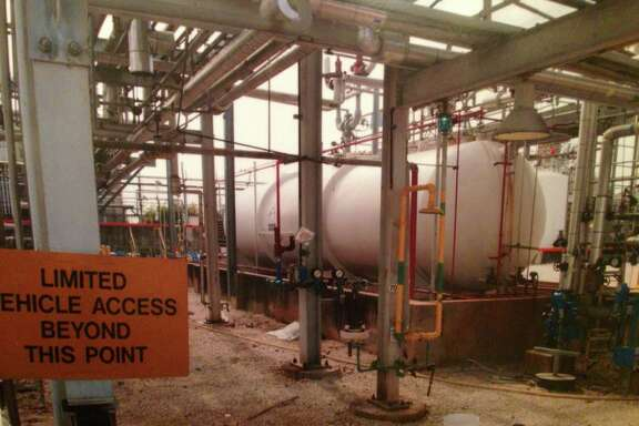 Toxic methyl mercaptan, stored as a liquid in this tank at DuPont's La Porte plant, backed up inside the building and emerged as a gas.